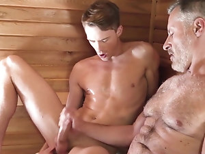 Silver daddy fucks young stud in a sauna (Preview)